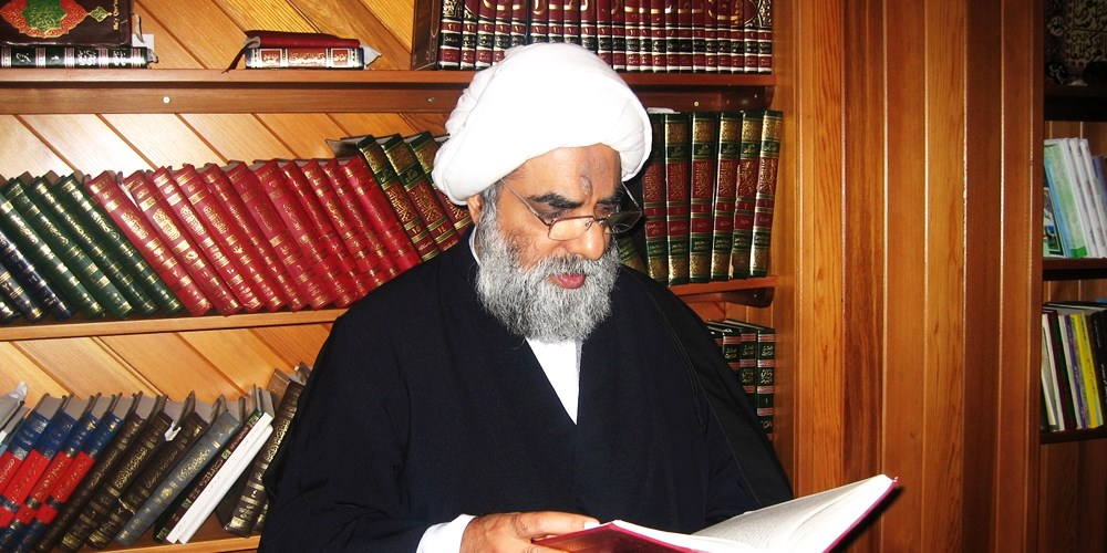 Sheikh-reading-at-his-Office